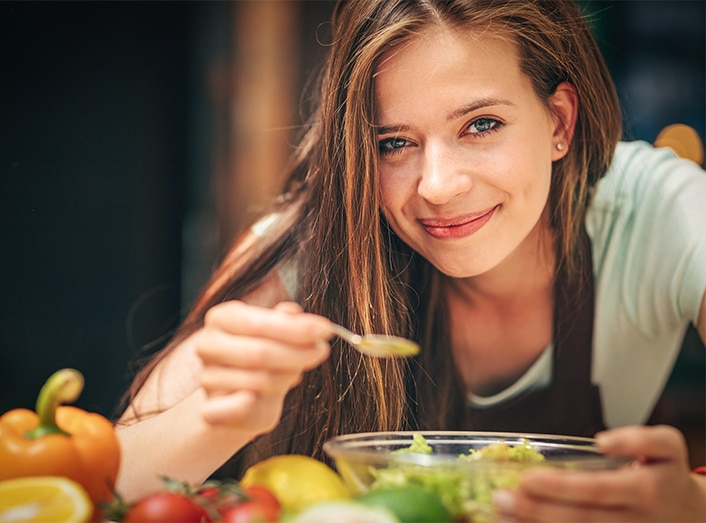 young-woman-in-the-kitchen-UV9BJ8A